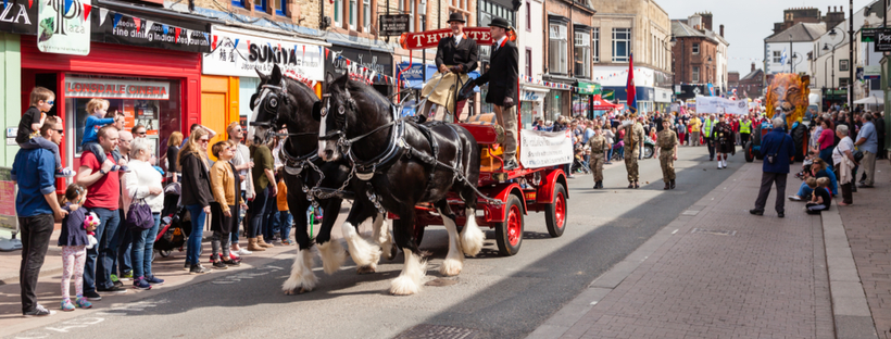 An image showing the high street and shops in penrith on May day
